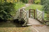 A bridge over a river in the park