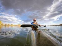 senior male paddling racing kayak