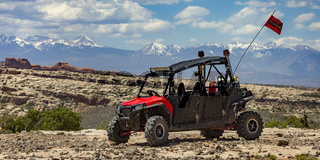 Off road vehicle in Moab with view of mountain