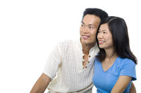 Asian couple looking away with copy space
