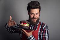 Man showing burger