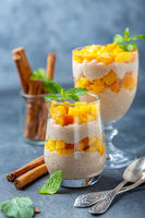 Rice pudding with peach slices for breakfast.