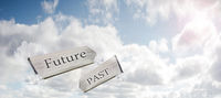 Concept image of Future Past and Present on a signpost against the sky with sunlight