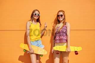 teenage girls with short skateboards outdoors