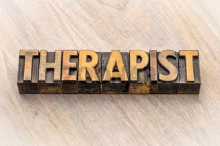 therapist word in wood type