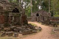 Fallen stone blocks beside stone temple buildings