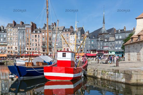 Fishing ship in old medieval harbor Honfleur, France