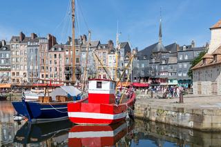 Fishing ship in old medieval harbor Honfleur, France