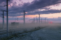 Railway at sunset with dust and thunderstorm