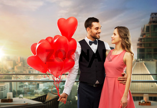 couple with heart shaped balloons in singapore