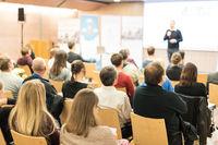 Speaker giving presentation on business conference.