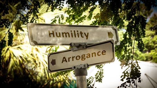 Street Sign to Humility versus Arrogance