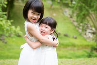 Sisters hugging at outdoors