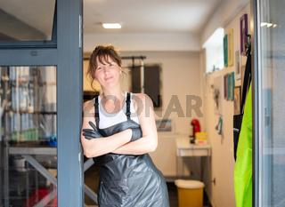 portrait of professional pet hairdresser woman