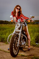 Biker girl and motorcycle