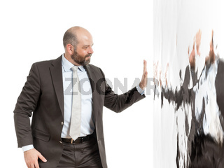 business man at a wall of water