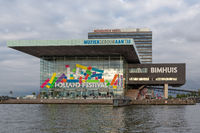 Contemporary architecture of Music building and hotel in harbor Amsterdam