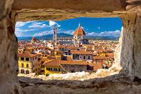 Florence square and cathedral di Santa Maria del Fiore or Duomo view through stone window