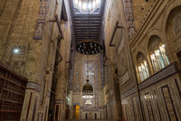 Interior of al Refai mosque with old decorated bricks stone wall and colored marble decorations, Cairo, Egypt