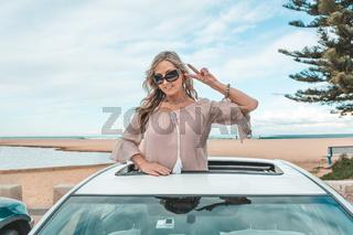 Fun woman enjoy travelling in her car