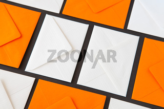 Composition with white and orange envelopes on the table. Different colored envelopes on the table.