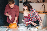 Dad cuts a pumpkin for a pie