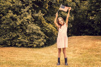 Happy girl with small american flag