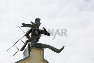 Chimney Sweeper Sculpture on roof in old town of Klaipeda, Lithuania