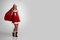 Santa woman with christmas gifts