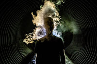 Man with smoke lifting from body in a tunnel