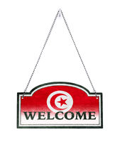 Tunisia welcomes you! Old metal sign isolated