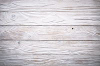 White wooden textured background of flat layed planks with weathered vintage painted surface