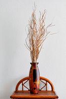 Dry flower arrangement  in wooden vase
