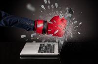 Hand breaks laptop screen