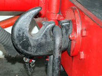 coupling hook from an old steam locomotive painted black on red buffers