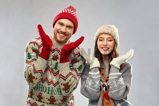 happy couple at christmas ugly sweater party