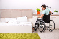 The young handsome disabled man recovering at home
