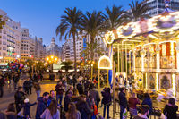 Christmas fair with carousel on Modernisme Plaza of the City Hall of Valencia, Spain.