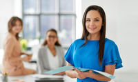 businesswoman with folder at office
