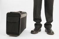 Beine und Koffer