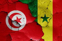 flags of Tunisia and Senegal painted on cracked wall