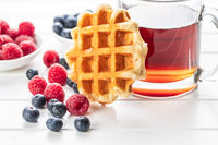 Waffles with blueberries and raspberries.