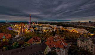 The Oktoberfest / Wiesn in Munich in total view at the evening