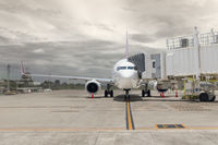 Airplane loading passenger at airport gate ramp