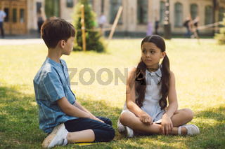 Two kids in school yard