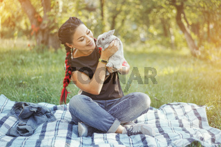 Close-up of Pretty Asian Hugging Bunny on Summer Nature