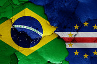 flags of Brazil and Cape Verde painted on cracked wall