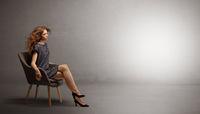 Elegant woman modeling in an empty studio
