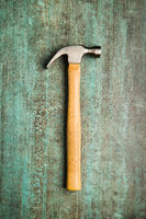 The claw hammer on grunge background.