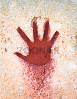 Red hand on stone - graphic gothic element